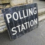 A chalk board showing a polling station